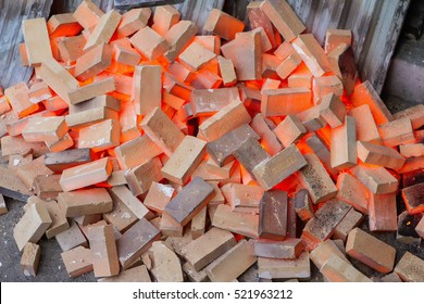 Spillage pile of red-hot fireclay bricks