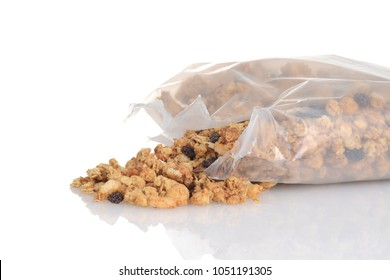 spilled bag of granola raisin almond cereal