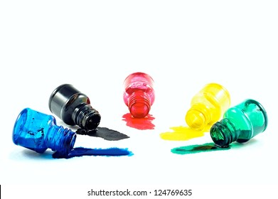 Spilled a bottle of blue, red,green,black and yellow  ink on white background