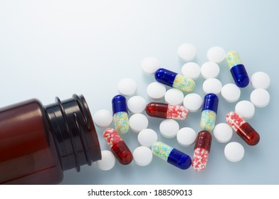 Spilled capsule medicines and tablets. Clean and bright medicine image.