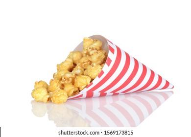 spilled caramel popcorn in a paper cone