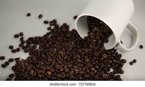 Spilled coffee beans on a white background