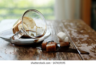 spilled coffee cup on wooden table