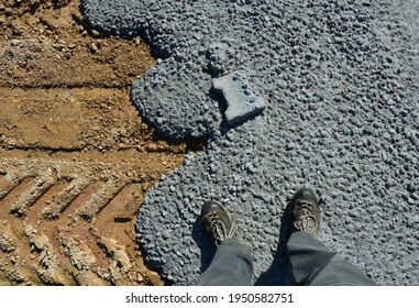 spilled concrete on the construction site solidified and lock paving was thrown inside. The landscape is generally concreted in a ruthless building industry. the concrete is already hard