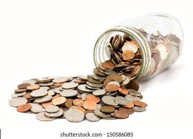 Spilled jar of coins isolated on white background