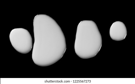 Spilled milk puddle isolated on black background and texture with clipping path, top view