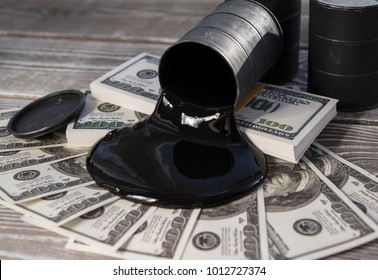 Spilled oil from a barrel to a dollar bill of money. Oil business. Profit from the sale of petroleum products, imports.