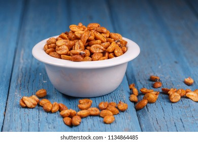 Spilled peanuts by a bowl.