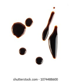 Spilled Soy Souse Teriyaki Texture. Oyster Sauce or Balsamic Vinegar Puddles on White Background Top View