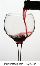 Spilling a glass of red wine.