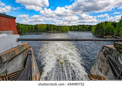 Spillway of hydroelectric power generation plant dam at Oat rapids of Kymijoki main stream in Mankala, Finland. Whitewater height of fall of 8.1 meters and a power plant of 25 MW.