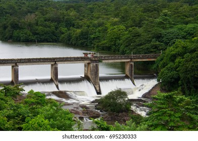 spillway thenmala dam overflowing  kollam kerala india