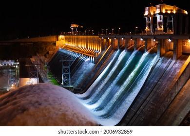 Spillway water to hydroelectric power station in Krasnoyarsk, Russia. Night industrial landscape with open locks on Krasnoyarsk Dam