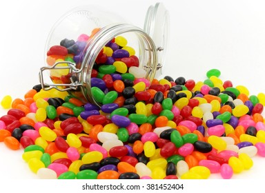 Spilt Jelly Beans from Glass Jar with Lid