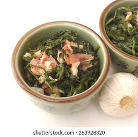 Spinach with bacon in a bowl
