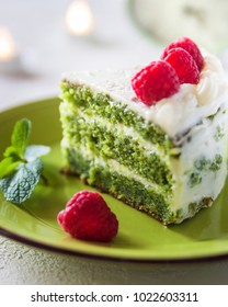 Spinach cake with cream and raspberry.