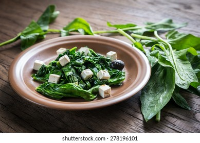 Spinach with cheese, olives