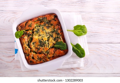 Spinach, egg and cheese casserole in a tin