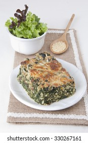 Spinach gratin with millet, baked, vegetarian food