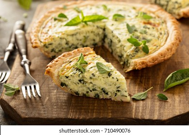 Spinach and herb Florentine quiche on a cutting board for breakfast