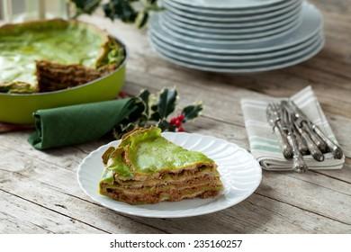 Spinach lasagna on Christmas table.
