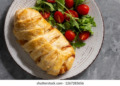 Spinach and mozzarella stuffed chicken breasts baked in puff pastry.