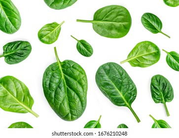 Spinach Pattern. Creative layout made of spinach leaves isolated on white background. Flat lay. Healthy Food concept.