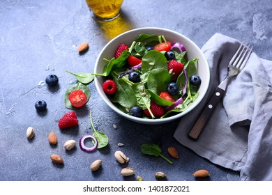 Spinach salad with berries and seeds, healthy lunch, summer snack, raw eating and diet