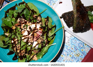 Spinach salad with feta and pomegranate sauce and kuku sabzi