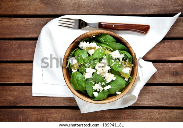 Spinach salad with oranges and sesame seeds, top view