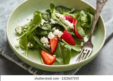 Spinach salad with strawberry and feta cheese