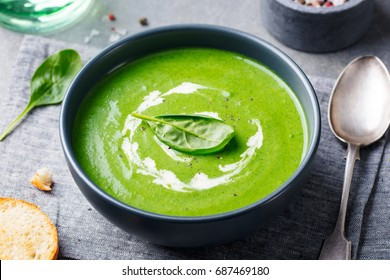 Spinach soup with cream in a bowl. Close up.