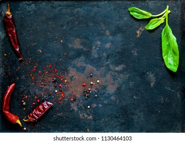 spinach and  spices, Various vegetarian ingredients on dark vintage background of old rusty metals, top view. Healthy food, vegan or diet nutrition concep copy space, closeup