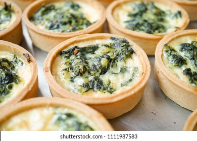 Spinach tarts. Closed up details of mini bite size quiche spinach appetizers.