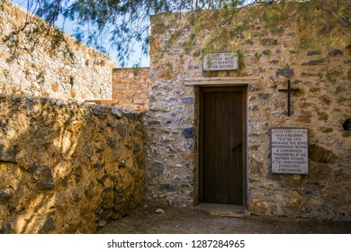 Spinalonga / Greece - September 27, 2018: Entrance to the historic chapel at the cemetery on the leper island. Historic buildings in the Spinalonga fortress, Crete.