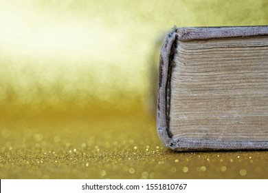 The spine of an old thick book lies on a yellow background. Library archive. History and memoirs. Educational and fiction. Close-up.