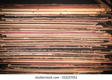 Spines of Vinyl record album covers in stack