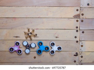 Spinner on a wooden background