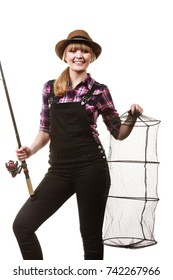 Spinning, angling, cheerful fisherwoman concept. Happy woman in sun hat holding fishing rod and keepnet having fun.