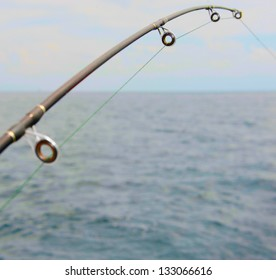 Spinning close-up in the hands of a fisherman at sea