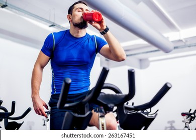 Spinning Instructor at Gym after class drinking water