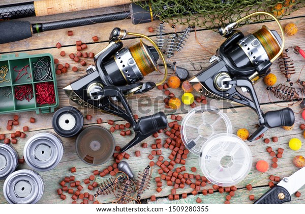 Spinning and reels, accessories for fishing on the table in composition