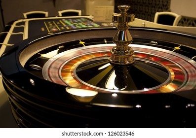 Spinning roulette in casino .
