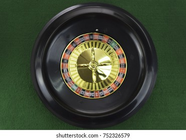 Spinning roulette wheel on green background