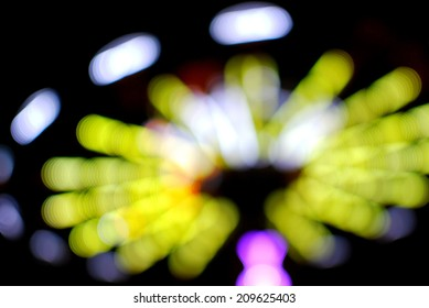 Spinning Swings Conveyed as Out of Focus, Blurry Balls of Light