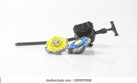 Spinning top of metal and plastic fusion beyblade or locally known in Malaysia as Gasing Moden. Concept of modern kid toys game. Isolated on white background.