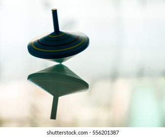 spinning top on mirror