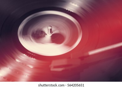 Spinning Vinyl Record with Red Light Leaks