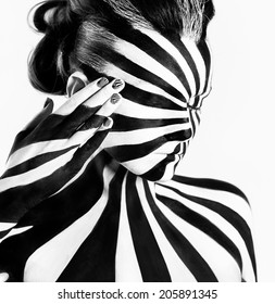 Spiral bodyart on the body of a young girl. Look like zebra pattern skin