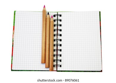 Spiral bound notebook with pencil over rattan desk- shallow dof